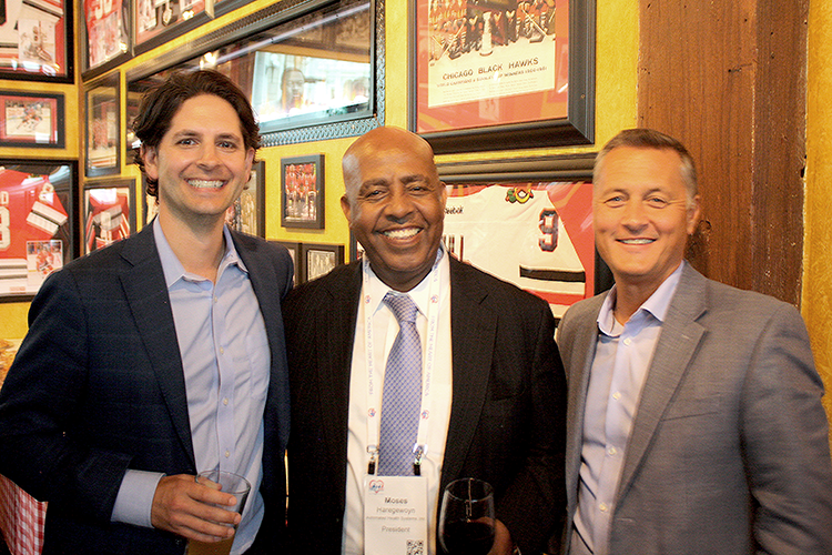Briljent President, Matt Odum (left), Automated Health Systems President, Moses Haregewoyn (center), and Briljent's Scott Lorch (right)