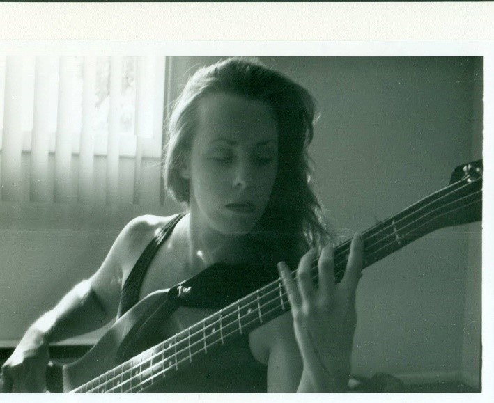 Health IT Rockstar, Susan Clark, with Bass Guitar